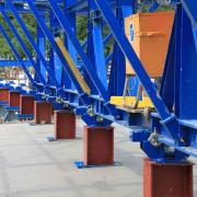 The composite forming carriage is designed to cope with the higher loads resulting from the large and non-uniform distances between the roller-trestle bearing supports.