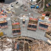 "The concrete arch dam is built on the basis of the ""leader-follower principle"": three blocks referred to as leaders serve as base supports. The second step is mounting the formwork between these blocks and to pour CIP concrete in the follower block."
