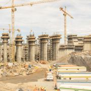 Gigantic proportions: Five spillways, central dam and the power house. <br /> Photo: Doka