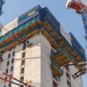 The building core is divided into three sections and is being built with Automatic climbing formwork SKE100 plus and SKE50 plus. The entire outside of a section can be climbed in a single operation with hydraulic cylinders and no apertures are opened up during climbing.
