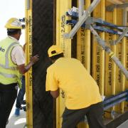 Doka Qatar Formwork Instructor guides workers on how to safely lift Large-area formwork Top 50 panel before casting. Photo: Doka